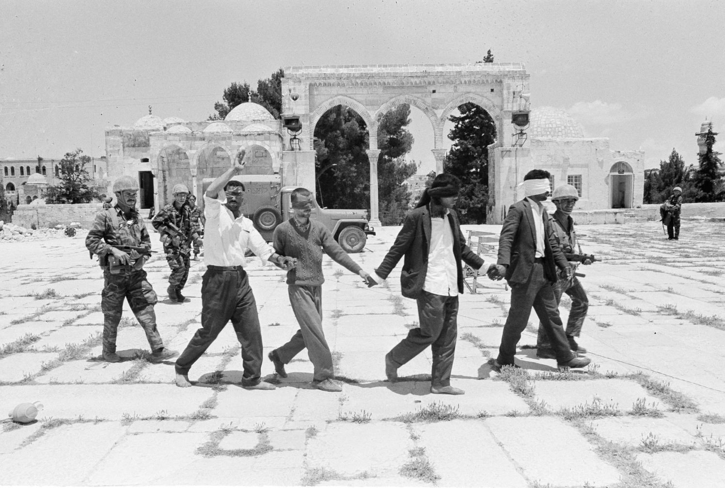 Arabs are led blindfolded to interrogation by Israeli soldiers in the old city of Jerusalem, June 8, 1967. (AP Photo)