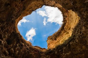 trou-Canva-Worms-eye-Photography-of-Hole-Under-Cloudy-Sky